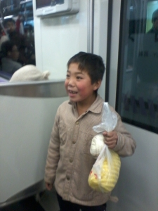 boy on metro with pineapple